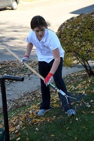 Grade 5 community leaf raking