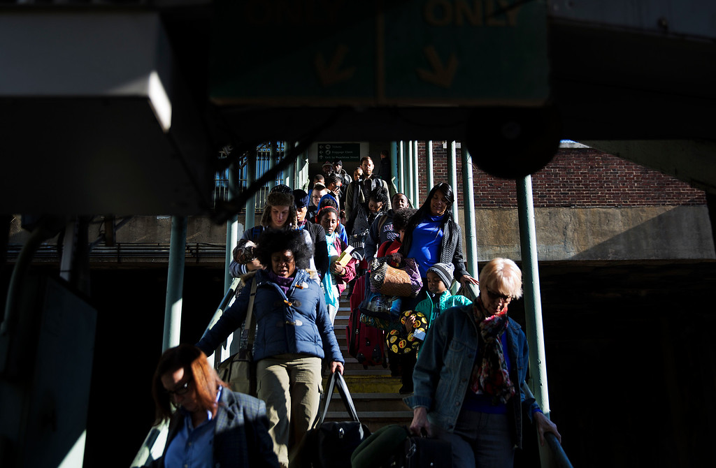. Travelers walk down a stairwell to board an Amtrak train heading to New Orleans in Atlanta, Wednesday, Nov. 23, 2016. Almost 49 million people are expected to travel 50 miles or more for the Thanksgiving holiday, the most since 2007, according to AAA. (AP Photo/David Goldman)
