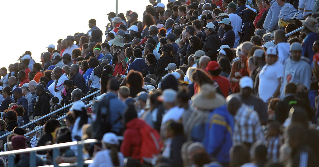 . A full house watches as Notre Dame\'s Khalfani Muhammad (not pictured) won the 100 meter Dash Invitational with a time of 10.46 during the Arcadia Invitational at Arcadia High School on Saturday, April 6, 2013 in Arcadia, Calif.  (Keith Birmingham Pasadena Star-News)