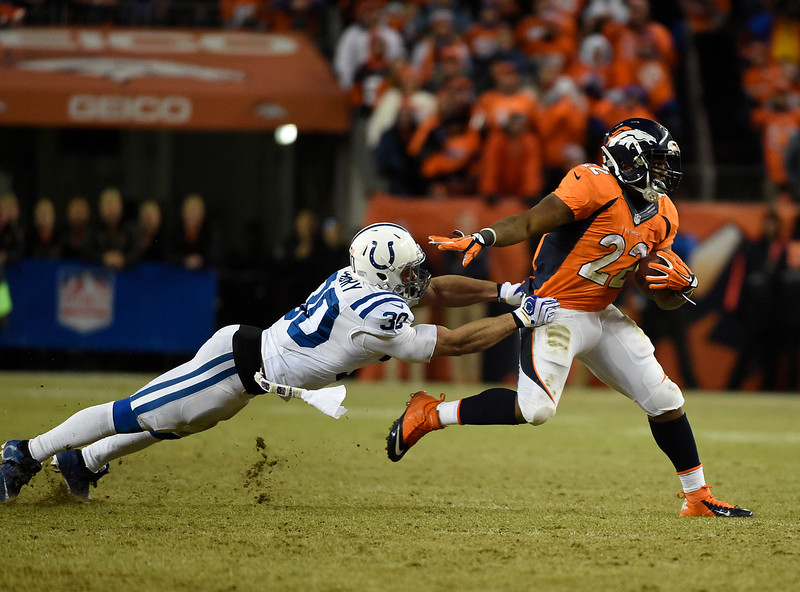 . C.J. Anderson (22) of the Denver Broncos breaks a tackle to pick up the first down in the third quarter. The Denver Broncos played the Indianapolis Colts in an AFC divisional playoff game at Sports Authority Field at Mile High in Denver on January 11, 2015. (Photo by Joe Amon/The Denver Post)