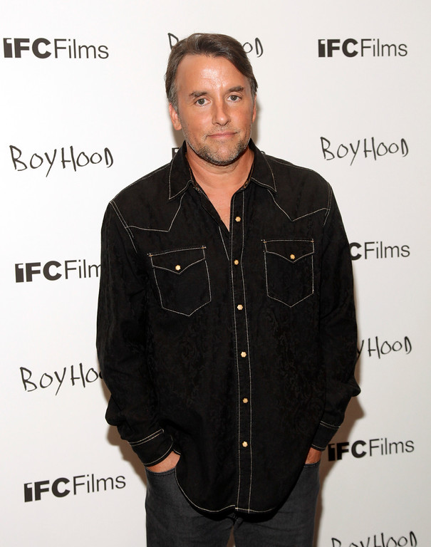 """. In this July 7, 2014 file photo, director Richard Linklater attends a screening of his film \""""Boyhood\"""" in New York. Linklater was nominated for a Golden Globe for best director for the film on Thursday, Dec. 11, 2014. The 72nd annual Golden Globe awards will air on NBC on Sunday, Jan. 11. (Photo by Andy Kropa/Invision/AP, File)"""