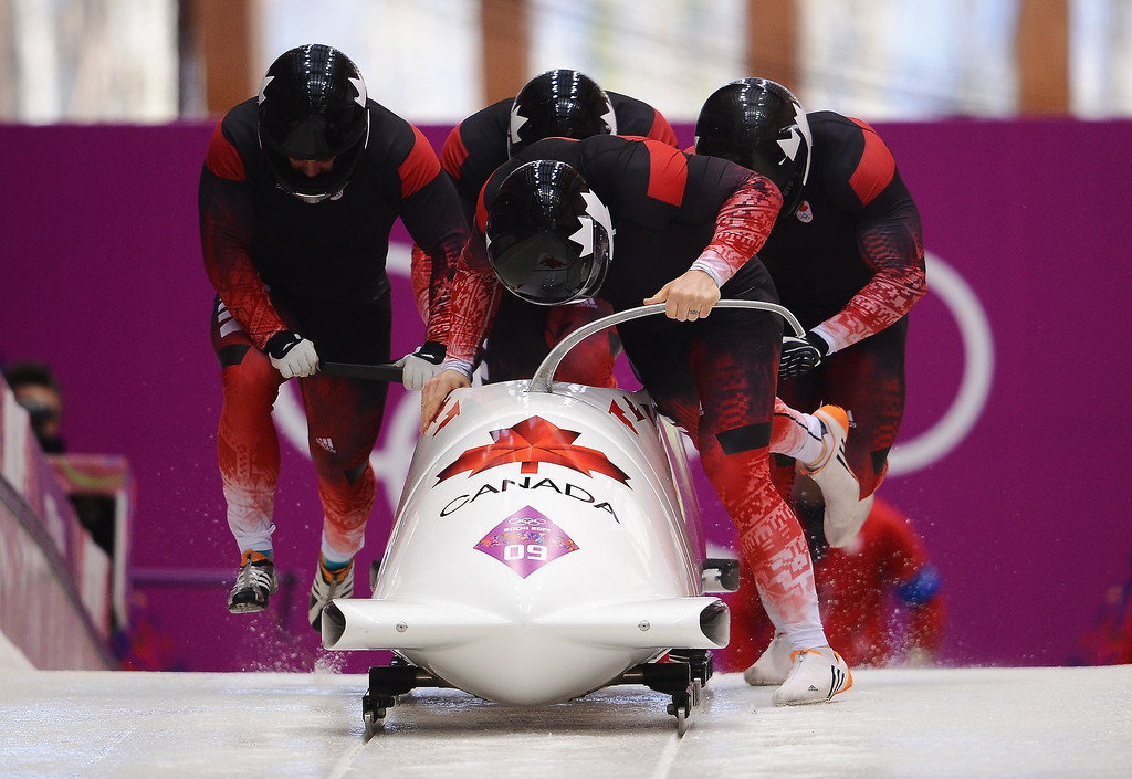 . Pilot Lyndon Rush, Lascelles Brown, David Bissett and Neville Wright of Canada team 2 make a run during the Men\'s Four-Man Bobsleigh on Day 16 of the Sochi 2014 Winter Olympics at Sliding Center Sanki on February 23, 2014 in Sochi, Russia.  (Photo by Lars Baron/Getty Images)