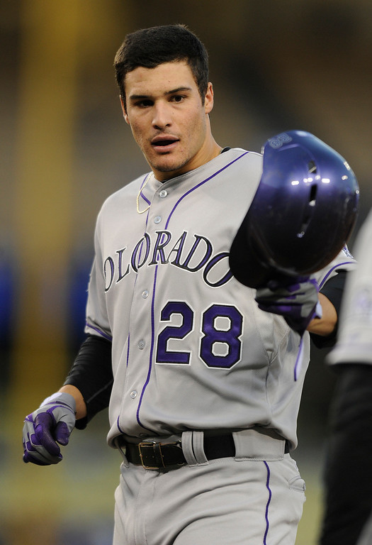 . Nolan Arenado passes off his helmet after a trip to the plate. The Los Angeles Dodgers played host to the Colorado Rockies in a game at Dodger Stadium in Los Angeles, CA 5/1/2013(John McCoy/Staff Photographer)
