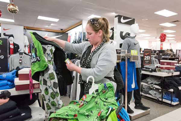 11/26/18 Wesley Bunnell | Staff Ashley Kelley of New Britain looks over items for her son while shopping at Kohl's in Plainville on Monday afternoon.
