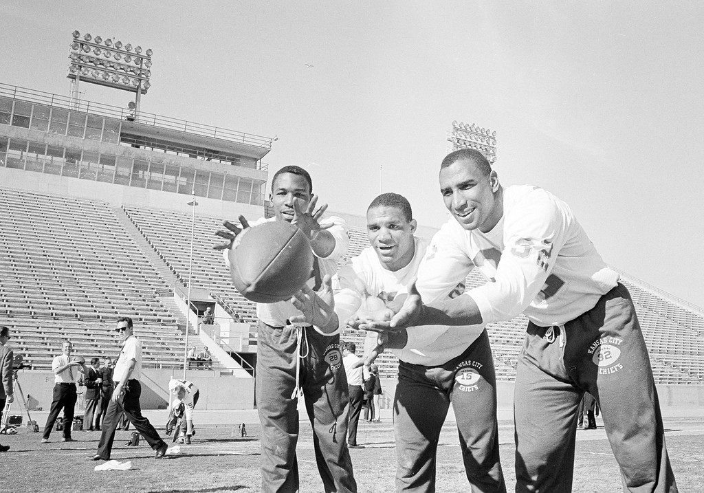 . Flanker Otis Taylor, left, running back Mike Garrett, center, and fullback Curtis McClinton of the Kansas City Chiefs, pose during a workout in Los Angeles, Calif., Jan. 11, 1967. The trio are expected to be the Chiefs\' principal scoring threats against the Green Bay Packers when they meet in the Super Bowl at the Los Angeles Memorial Coliseum. The AFL champs will be meeting their NFL counterparts for the world title. (AP Photo/George Brich)