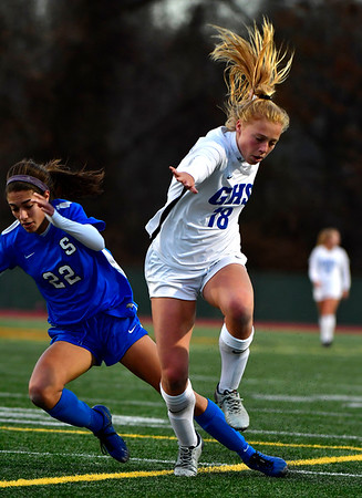 11/23/2019 Mike Orazzi | Staff Southington High School's Morgan Hubert (22) and Glastonbury's Madison McGraw (18) during the Class LL Girls State Soccer Tournament at Veterans Stadium in New Britain Saturday evening. Glastonbury won 1-0.