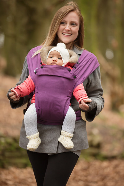 Izmi_Baby_Carrier_Cotton_Midnight_Purple_Lifestyle_Front_Carry_Mum_Holding_Baby_Hands.jpg