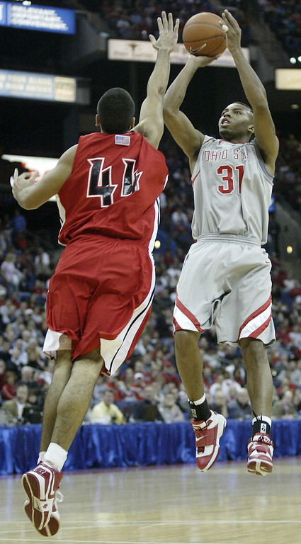 . Ohio State\'s Daequan Cook, right, shoots over Youngstown State\'s George Cotal during the first half of an NCAA basketball game Friday, Nov. 24, 2006, in Columbus, Ohio. (AP Photo/Jay LaPrete)