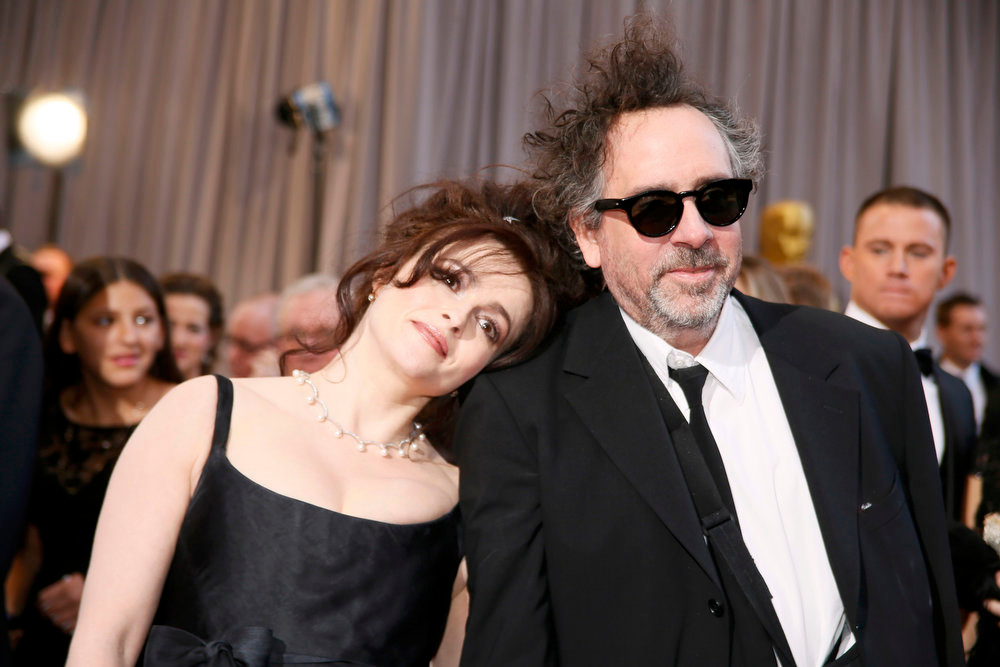 Description of . British actress Helena Bonham Carter (L) rests her head on the shoulder of her partner director Tim Burton, nominee for Director of Best Animated Feature film
