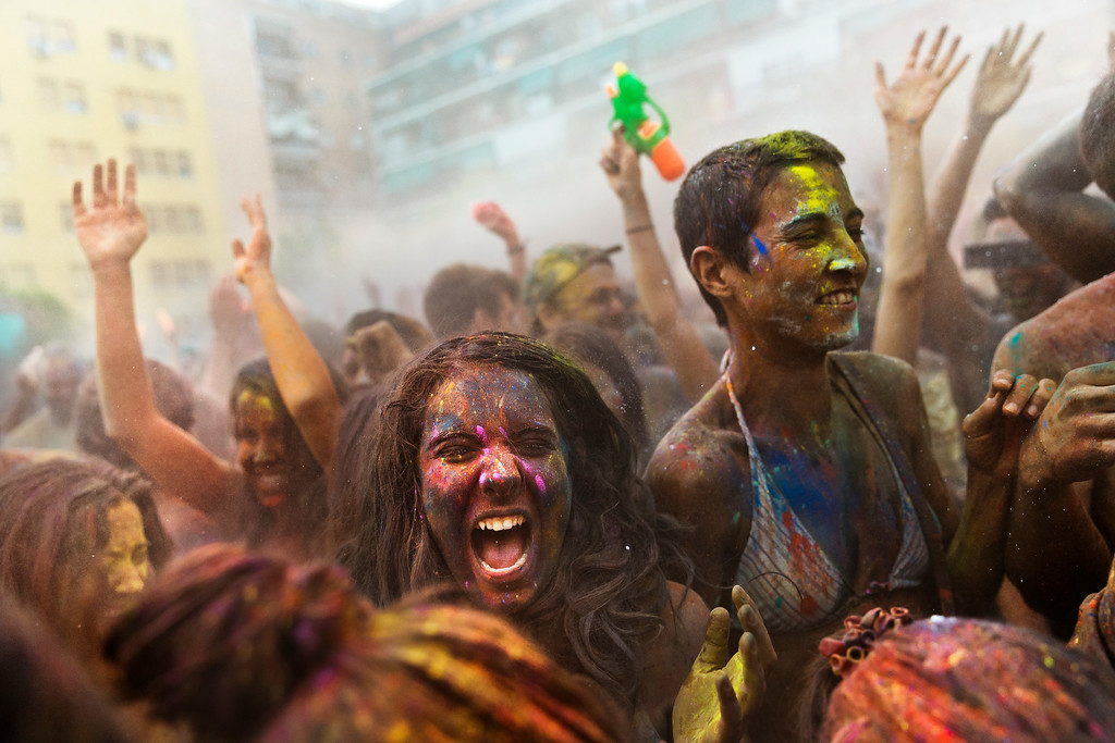 . Revelers of the Holi Festival of Colors throw colored powder in the air, in Madrid, Spain, Saturday, Aug. 9, 2014.  (AP Photo/Daniel Ochoa de Olza)
