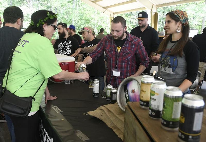 9/2/2017 Mike Orazzi | Staff Nikki Vinci gets a beer sample from Matt Westfall and Niki Ellis of Counter Weight Brewing Company during the 2nd CT Hops for Hope beer festival held at Falcon Field in New Britain Saturday.