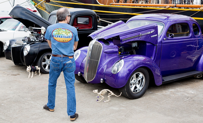 Sean and skeletal friends admiring a pair of Hot Rods