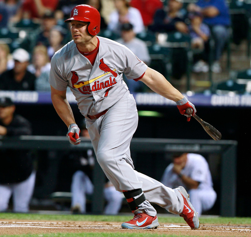 . St. Louis Cardinals\' Matt Holliday grounds out against the Colorado Rockies to close the top of the first inning of a baseball game in Denver on Wednesday, Sept. 18, 2013. (AP Photo/David Zalubowski)