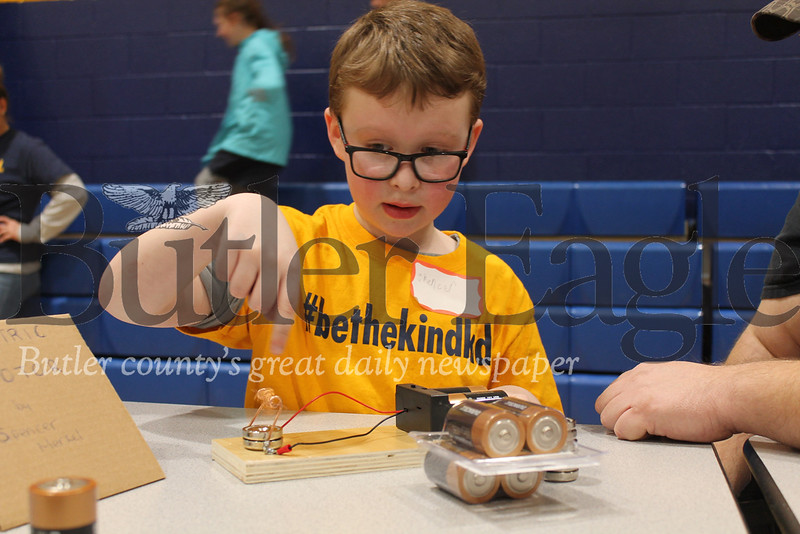 """""""Mars Area second grader Spencer Merkel built a mini motor with copper wire and two Duracell batteries for the Mars Area Elementary Science Fair. Spencer's dad taught him copper isn't magnetic, but can generate an electromagnetic field when it conducts electricity.""""Photo by Samantha Beal."""