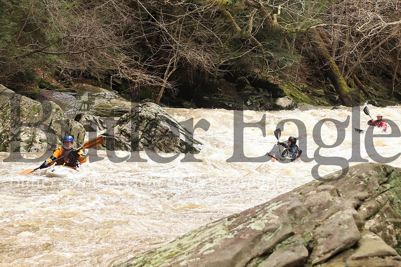 Following Saturday storms, a group of whitewater kayakers brave  high water conditions on Slippery Rock Creek, above McConnell's Mill, Easter Sunday. Seb Foltz/Butler Eagle