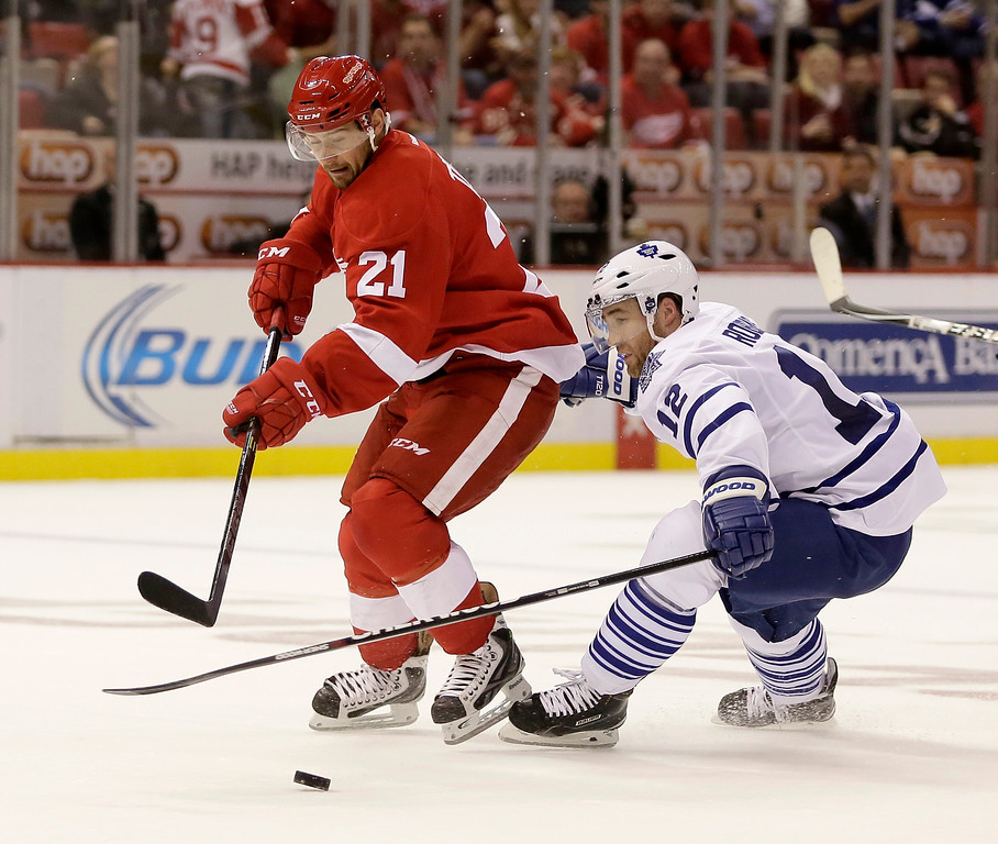 . Detroit Red Wings\' Tomas Tatar (21), of Slovakia, skates to the goal against Toronto Maple Leafs\' Stephane Robidas during the second period of an NHL hockey games Saturday, Oct. 18, 2014, in Detroit. (AP Photo/Duane Burleson)