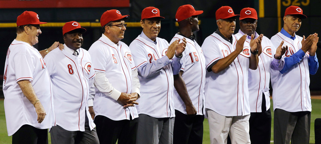 . The starting eight of the 1975-76 World Series-winning Cincinnati Reds, left to right, Pete Rose, Joe Morgan, Johnny Bench, Tony Perez, George Foster, Dave Concepcion, Ken Griffey Sr., and Cesar Geronimo, line up during ceremonies honoring them following a baseball game between the Reds and the Los Angeles Dodgers, Friday, Sept. 6, 2013, in Cincinnati. (AP Photo/Al Behrman)