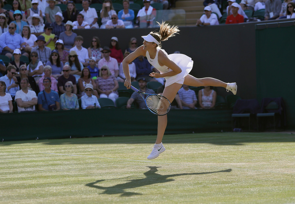 . Maria Sharapova of Russia serves to Vitalia Diatchenko of Russia during their women\'s singles match on the second day at the Wimbledon Tennis Championships in London, Tuesday July 3, 2018. (AP Photo/Kirsty Wigglesworth)