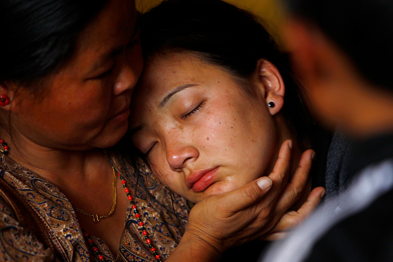 . Daughter of Nepalese mountaineer Ang Kaji Sherpa, killed in an avalanche on Mount Everest, cries as her father\'s body is brought to the Sherpa Monastery in Katmandu, Nepal, Saturday, April 19, 2014. Rescuers were searching through piles of snow and ice on the slopes of Mount Everest on Saturday for four Sherpa guides who were buried by an avalanche that killed 12 other Nepalese guides in the deadliest disaster on the world\'s highest peak. The Sherpa people are one of the main ethnic groups in Nepal\'s alpine region, and many make their living as climbing guides on Everest and other Himalayan peaks. (AP Photo/Niranjan Shrestha)