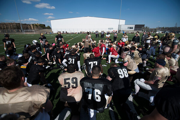 DAVID LIPNOWSKI / WINNIPEG FREE PRESS  Winnipeg Bisons Football head coach Brian Dobie speaks to players during the University of Manitoba Bisons 2016 spring camp prior to a scrimmage to close out their camp Sunday May 1, 2016 at the University of Manitoba Turf Fields.