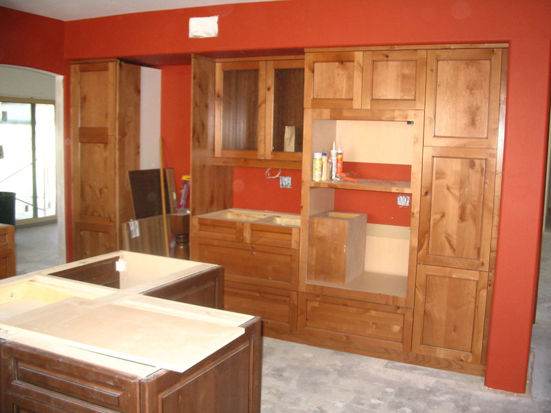 Except for the appliances and the countertop, this wall of cabinets is complete.