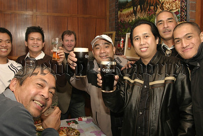 Newry & District Philipino Community people enjoy a pint at their Christmass Party .06W01N54
