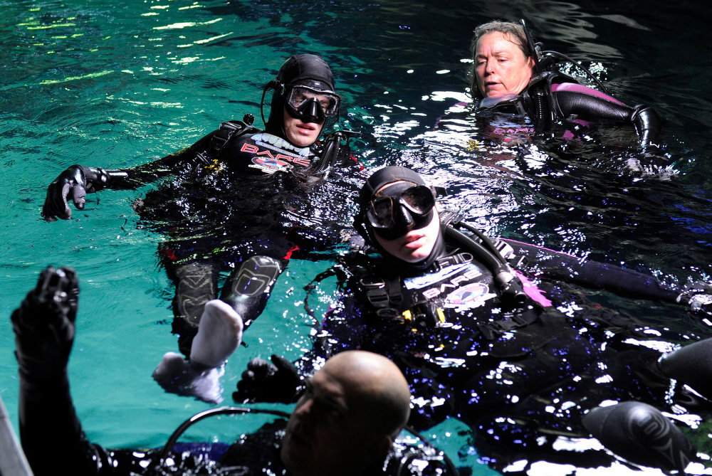 . DENVER, CO. - FEBRUARY 16: After his dive, Jonathan Wallace, 19, top left, who has cerebral palsy, makes his way to the water surface with his instructors. Two teens from the Riley Children\'s Foundation are learning how to scuba dive with instructors from the A-1 Scuba and Travel Aquatics Center at the Downtown Aquarium.(Photo By Kathryn Scott Osler/The Denver Post)