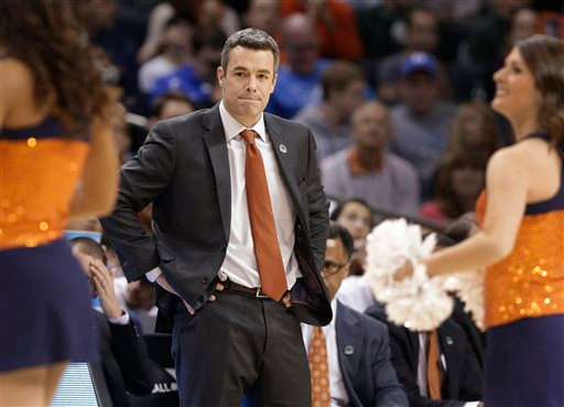 . Virginia head coach Tony Bennett looks toward his team during a timeout during the first half of an NCAA tournament college basketball game against Michigan State in the Round of 32 in Charlotte, N.C., Sunday, March 22, 2015. (AP Photo/Nell Redmond)