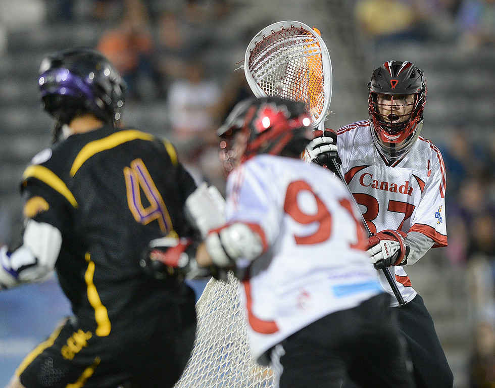 . COMMERCE CITY, CO - JULY 17: Canada goalie Dillon Ward (37) eyed the action in the second half. The Iroquois Nationals took on Canada in a FIL World Championship semifinal game Thursday night, July 17, 2014.  Photo by Karl Gehring/The Denver Post
