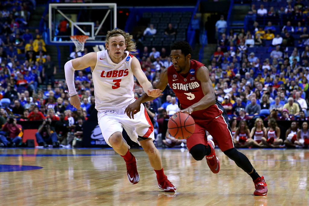 . Chasson Randle #5 of the Stanford Cardinal drives to the basket against Hugh Greenwood #3 of the New Mexico Lobos during the second round of the 2014 NCAA Men\'s Basketball Tournament at Scottrade Center on March 21, 2014 in St Louis, Missouri.  (Photo by Dilip Vishwanat/Getty Images)