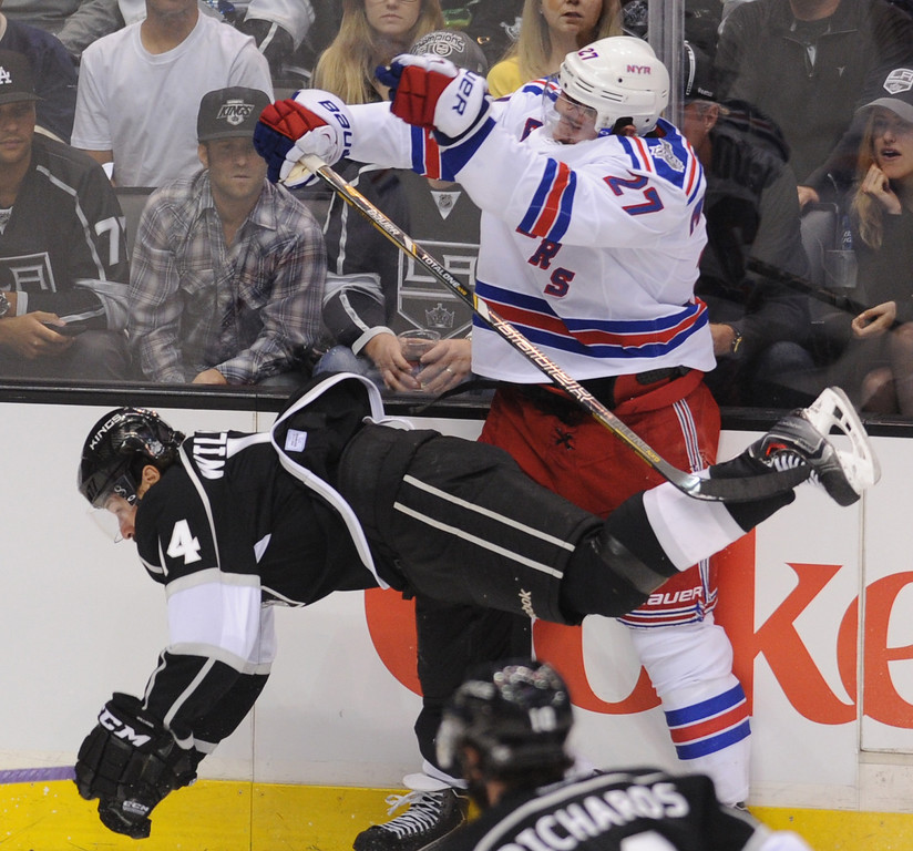 . Kings Justin Williams gets tripped up by Rangers Ryan McDonagh in the 2nd period. The Los Angeles Kings faced the New York Rangers in game 1 of the Stanley Cup Finals. Los Angeles, CA. 6/4/2014(Photo by John McCoy / Los Angeles Daily News)