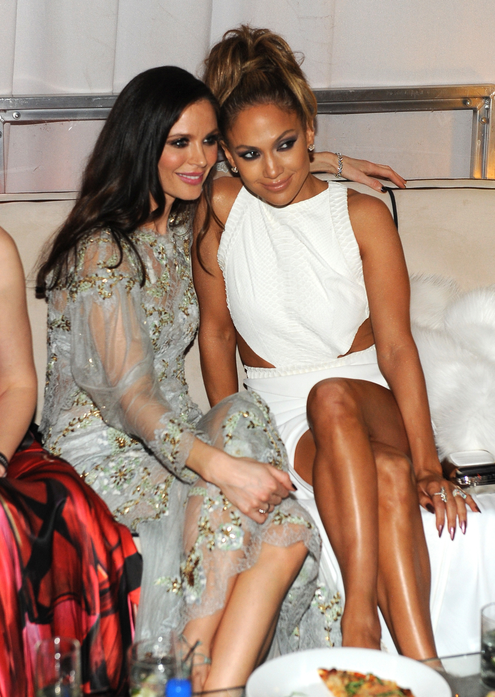 . Designer  Georgina Chapman (L) and singer Jennifer Lopez atten The Weinstein Company & Netflix\'s 2015 Golden Globes After Party presented by FIJI Water, Lexus, Laura Mercier and Marie Claire at The Beverly Hilton Hotel on January 11, 2015 in Beverly Hills, California.  (Photo by Angela Weiss/Getty Images for TWC)