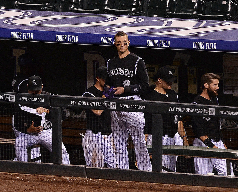 . Troy Tulowitzki watched the Braves celebrate another win Tuesday night. The Atlanta Braves defeated the Colorado Rockies 13-10 Tuesday night, June 10, 2014. (Photo by Karl Gehring/The Denver Post)
