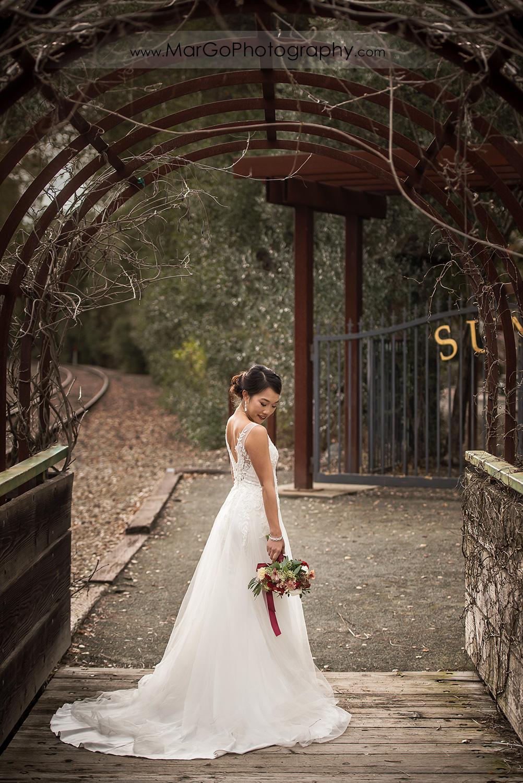 bride in green tunnel near Sunol's Casa Bella