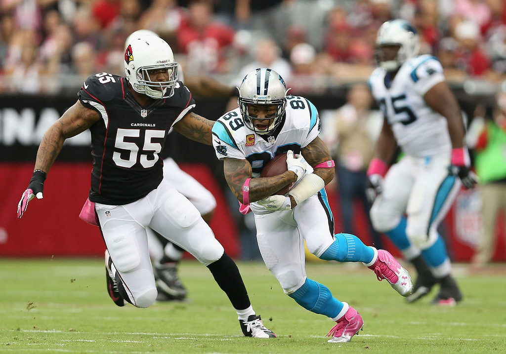 . Wide receiver Steve Smith #89 of the Carolina Panthers runs with the football after a reception past defensive end John Abraham #55 of the Arizona Cardinals during the NFL game at the University of Phoenix Stadium on October 6, 2013 in Glendale, Arizona.  (Photo by Christian Petersen/Getty Images)