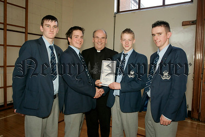 St Colmans College Junior prizegiving. Niall Burns recieves the Library award from Dr Francis Brown. Also in picture are school Prefects, Edward O'Hare, Michael Mulvanny and Gary Buchanan.