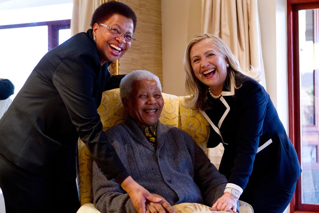 . Secretary of State Hillary Rodham Clinton meets with former South Africa President Nelson Mandela, 94,  and his wife Graca Machel at his home in Qunu, South Africa, Monday, Aug. 6, 2012. (AP Photo/Jacquelyn Martin, Pool)