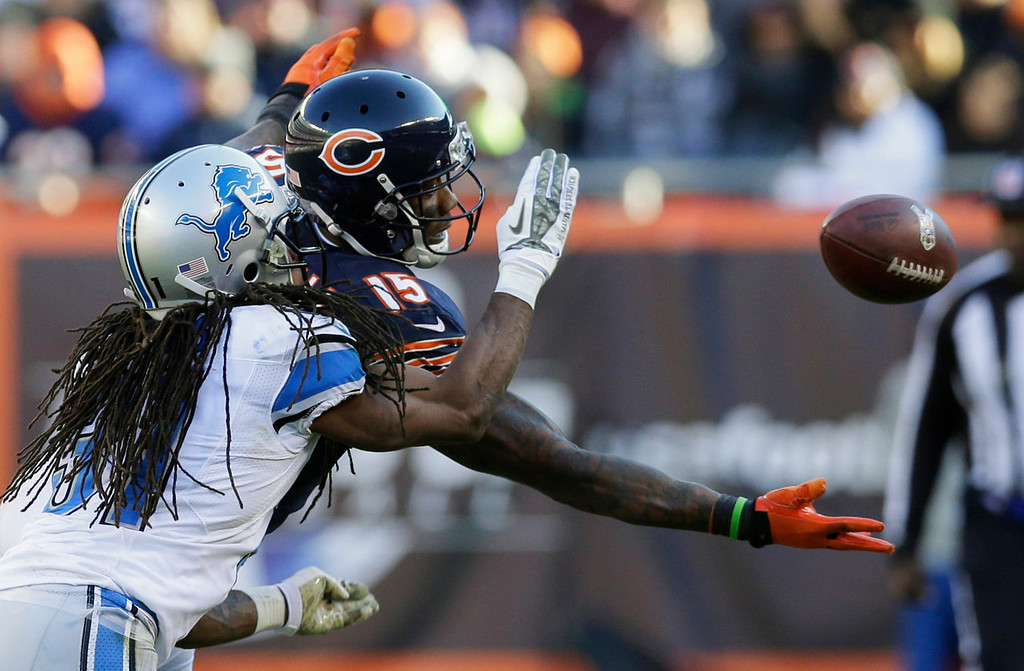 . Chicago Bears wide receiver Brandon Marshall (15) misses a catch under pressure from Detroit Lions cornerback Rashean Mathis during the second half of an NFL football game, Sunday, Nov. 10, 2013, in Chicago. (AP Photo/Nam Y. Huh)
