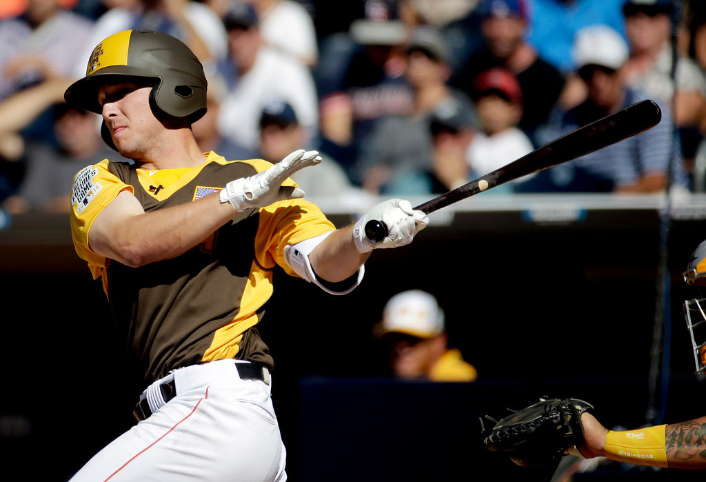. U.S. Team\'s Alex Bregman, of the Houston Astros, hits against the World Team during the first inning of the All-Star Futures baseball game, Sunday, July 10, 2016, in San Diego. (AP Photo/Matt York)