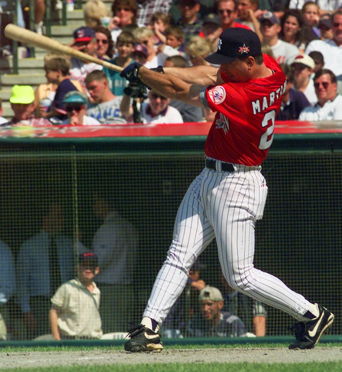 . New York Yankees\' Tino Martinez swings during the home run derby Monday, July 7, 1997  during All-Star festivities in Cleveland.  Martinez won the event. The All-Star game will be played Tuesday July 8, 1997. (AP Photo/Beth Keiser)
