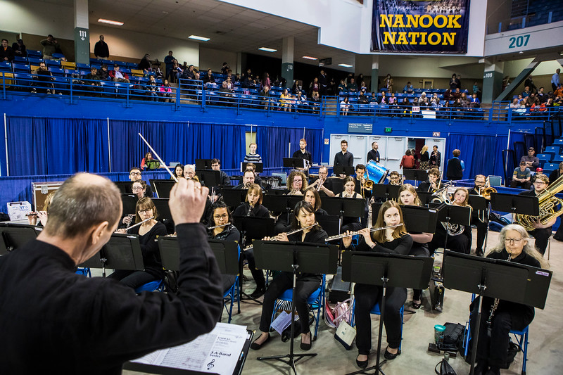 The UAF Wind Symphony, directed by George Rydlinski, plays the processional  during UAF's 2018 commencement ceremony on May 5, 2018.