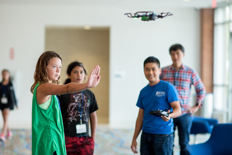 Nora Wold (left) uses hand gestures to give flight controls to the drone during the 2017 UAS Summer Camp at TAMU-CC.