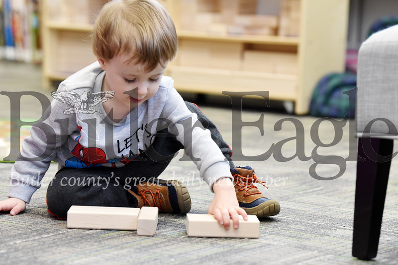 Harold Aughton/Butler Eagle: Cooper Hempfling, 3, plays with blocks at the Slippery Rock Library, Friday, December 27, 2019.