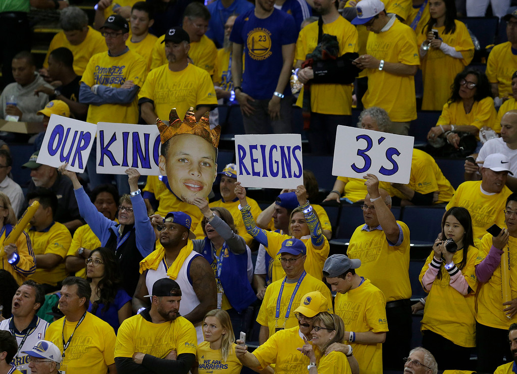 . Fans hold up signs for Golden State Warriors guard Stephen Curry during the second half of Game 1 of basketball\'s NBA Finals between the Warriors and the Cleveland Cavaliers in Oakland, Calif., Thursday, June 1, 2017. (AP Photo/Ben Margot)