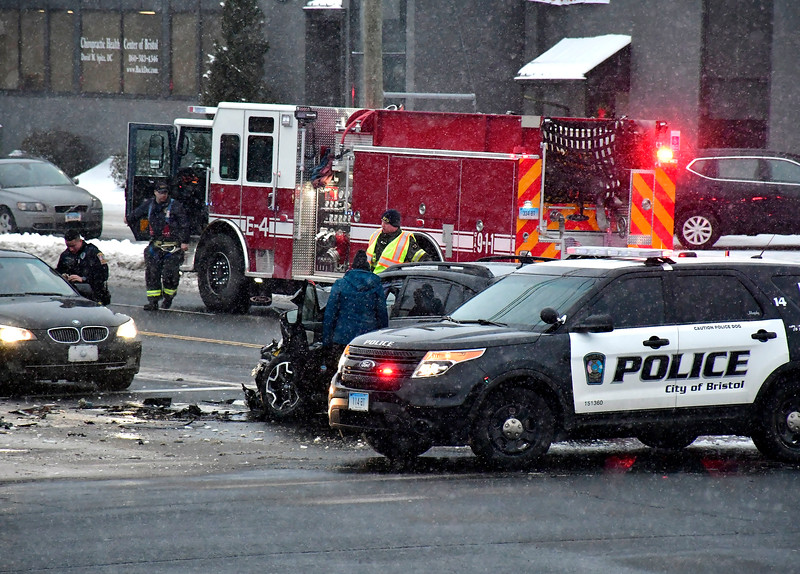 1/30/2019 Mike Orazzi | Staff The scene of a two car crash at the intersection of PIne and Middle Streets in Bristol Wednesday evening. Both vehicles, a Jeep and a Subaru, were towed from the scene and no patients were transported.