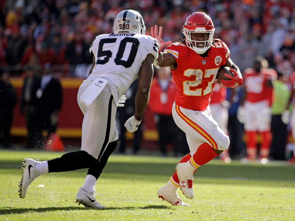 . Oakland Raiders linebacker Nicholas Morrow (50) closes in on Kansas City Chiefs running back Kareem Hunt (27) during the first half of an NFL football game in Kansas City, Mo., Sunday, Dec. 10, 2017. (AP Photo/Charlie Riedel)