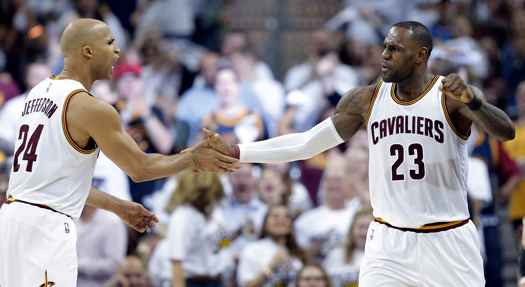 . Cleveland Cavaliers\' LeBron James (23) and Richard Jefferson (24) celebrate in the second half in Game 1 of a first-round NBA basketball playoff series against the Indiana Pacers, Saturday, April 15, 2017, in Cleveland. (AP Photo/Tony Dejak)