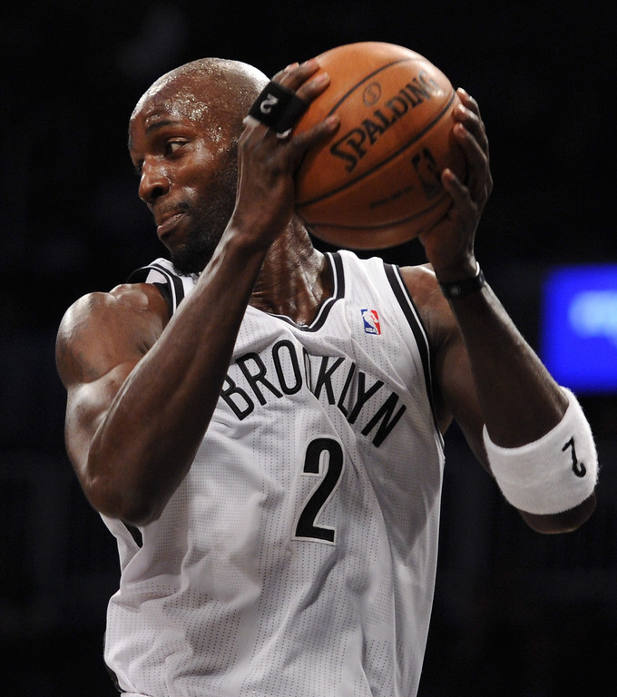 . NEW YORK, NY - DECEMBER 03:  Kevin Garnett #2 of the Brooklyn Nets grabs a rebound during the first quarter against the Denver Nuggets at Barclays Center on December 3, 2013 in the Brooklyn borough of New York City.  (Photo by Maddie Meyer/Getty Images)