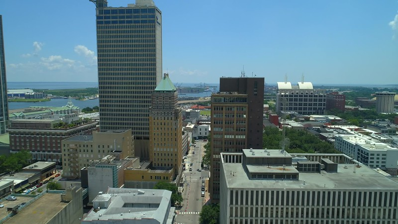 Aerial drone flying low through downtown towers Mobile Alabama USA