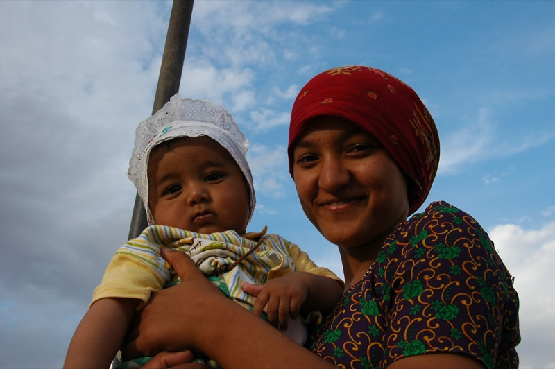 Woman Holding A Baby - Jerbent, Turkmenistan